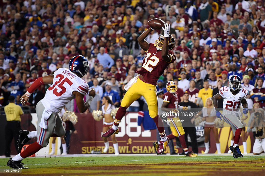 Wide receiver Andre Roberts of the Washington Redskins catches a pass for a 2nd quarter touchdown against the New York Giants at FedExField on...
