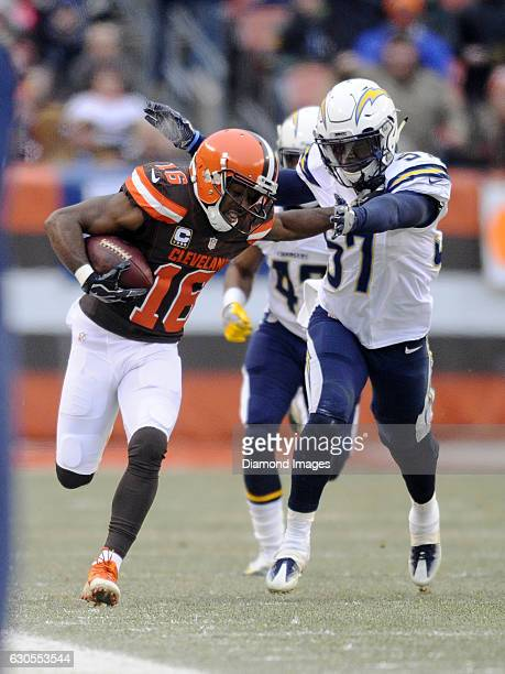 Wide receiver Andrew Hawkins of the Cleveland Browns carries the ball downfield as he stiffarms linebacker Jatavis Brown of the San Diego Chargers...