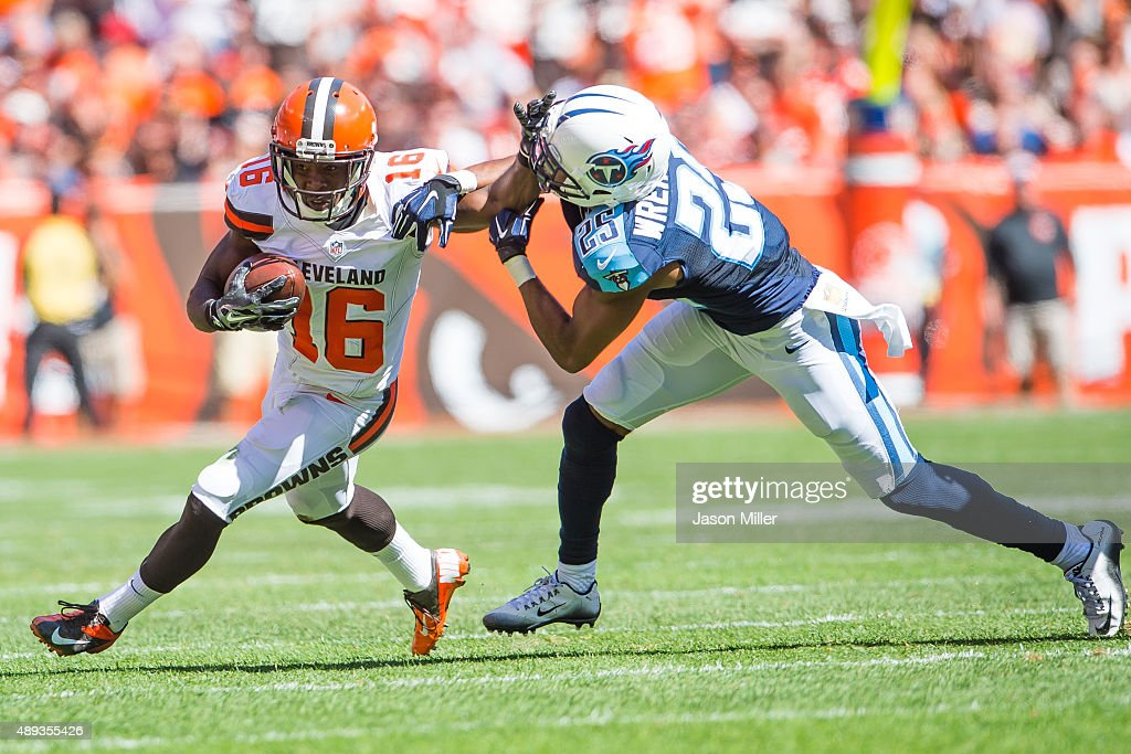 Wide receiver Andrew Hawkins #16 of the Cleveland Browns is tackled by cornerback Blidi Wreh-Wilson #25 of the Tennessee Titans during the first half at FirstEnergy Stadium on September 20, 2015 in Cleveland, Ohio.