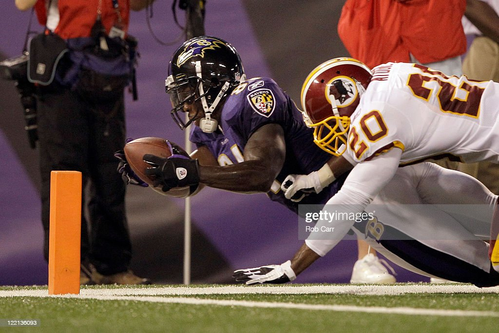 Wide receiver <a gi-track='captionPersonalityLinkClicked' href=/galleries/search?phrase=Anquan+Boldin&family=editorial&specificpeople=182484 ng-click='$event.stopPropagation()'>Anquan Boldin</a> #81 of the Baltimore Ravens is stopped short of the goal line by Oshiomogho Atogwe #20 of the Washington Redskins during the first half of a preseason game at M&T Bank Stadium on August 25, 2011 in Baltimore, Maryland.