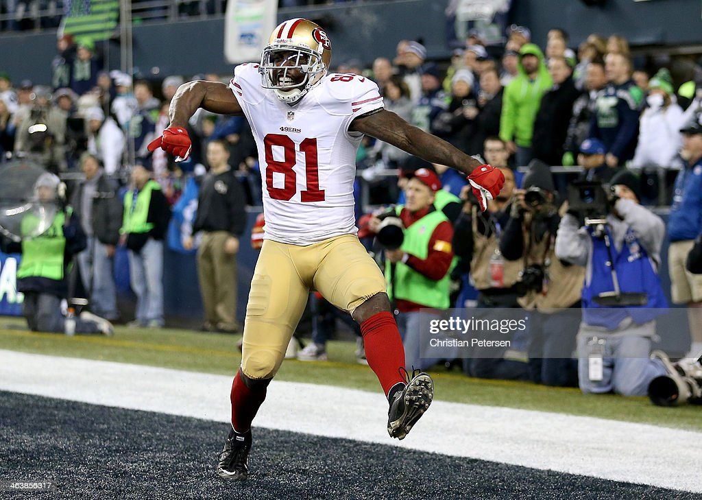 Wide receiver <a gi-track='captionPersonalityLinkClicked' href=/galleries/search?phrase=Anquan+Boldin&family=editorial&specificpeople=182484 ng-click='$event.stopPropagation()'>Anquan Boldin</a> #81 of the San Francisco 49ers celebrates after making a 26-yard touchdown catch against the Seattle Seahawks in the third quarter during the 2014 NFC Championship at CenturyLink Field on January 19, 2014 in Seattle, Washington.