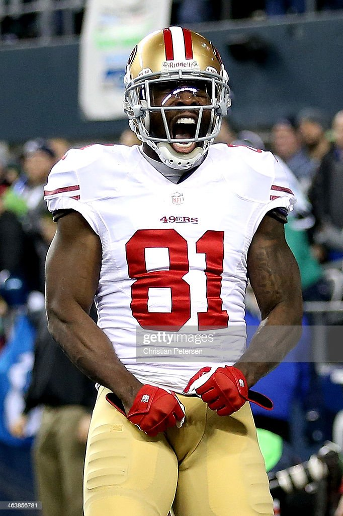 Wide receiver Anquan Boldin #81 of the San Francisco 49ers celebrates after making a 26-yard touchdown catch against the Seattle Seahawks in the third quarter during the 2014 NFC Championship at CenturyLink Field on January 19, 2014 in Seattle, Washington.