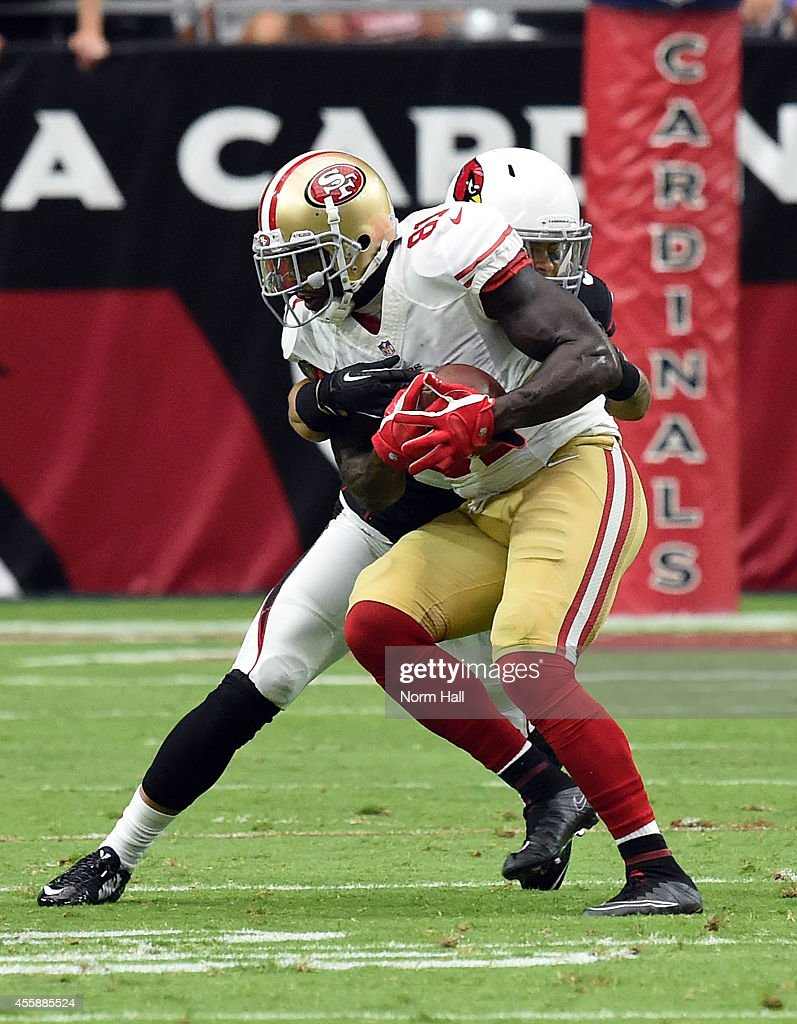 Wide receiver <a gi-track='captionPersonalityLinkClicked' href=/galleries/search?phrase=Anquan+Boldin&family=editorial&specificpeople=182484 ng-click='$event.stopPropagation()'>Anquan Boldin</a> #81 of the San Francisco 49ers is hit by safety <a gi-track='captionPersonalityLinkClicked' href=/galleries/search?phrase=Tyrann+Mathieu&family=editorial&specificpeople=7173040 ng-click='$event.stopPropagation()'>Tyrann Mathieu</a> #32 of the Arizona Cardinals during the second quarter of the NFL game at University of Phoenix Stadium on September 21, 2014 in Glendale, Arizona.