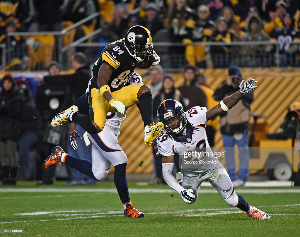 Wide receiver Antonio Brown #84 of the Pittsburgh Steelers leaps as he tries to avoid cornerbacks Kayvon Webster (partially hidden) and Bradley Roby #29 of the Denver Broncos during a game at Heinz Field on December 20, 2015 in Pittsburgh, Pennsylvania. The Steelers defeated the Broncos 34-27.