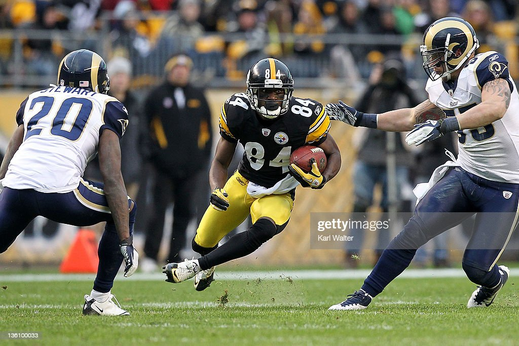 Wide receiver Antonio Brown #84 of the Pittsburgh Steelers rushes for yards after a catch during the game against the St. Louis Rams at Heinz Field on December 24, 2011 in Pittsburgh, Pennsylvania. Brown broke the Pittsburgh Steelers single season all purpose yardage during the game.
