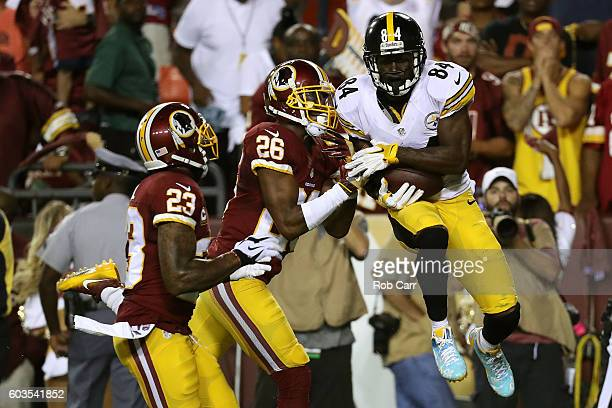 Wide receiver Antonio Brown of the Pittsburgh Steelers scores a second quarter touchdown past cornerback Bashaud Breeland and strong safety DeAngelo...