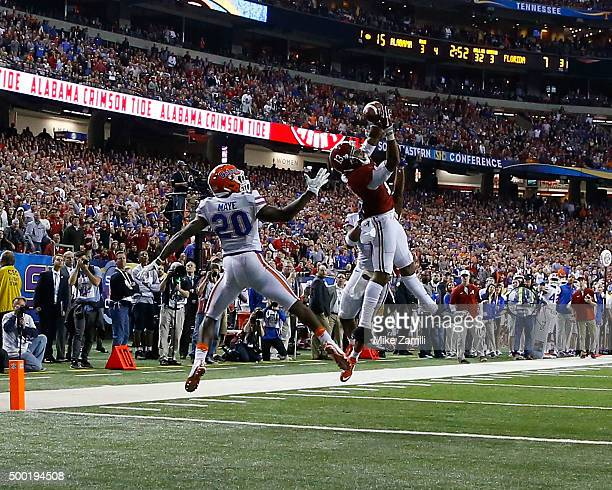 Wide receiver ArDarius Stewart of the Alabama Crimson Tide hauls in a touchdown pass in front of defensive back Marcus Maye of the Florida Gators...