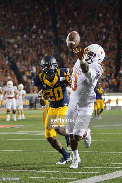 Wide receiver Armanti Foreman of the Texas Longhorns can't quite get his fingers on a long pass against cornerback Josh Drayden of the California...