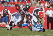 Wide receiver Arrelious Benn of the Tampa Bay Buccaneers rushes upfield with a pass against the Detroit Lions during the season opener September 11...