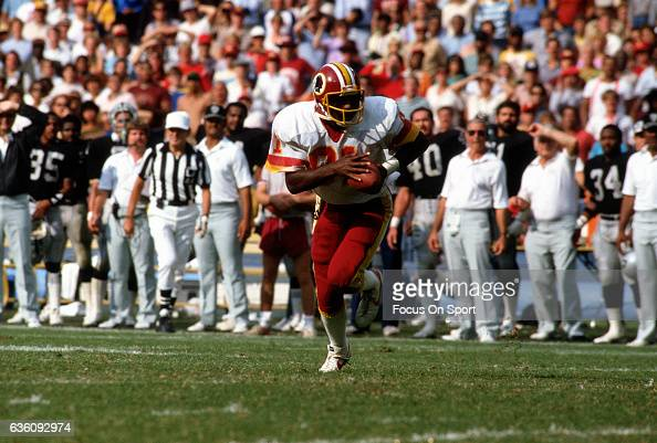Wide Receiver Art Monk of the Washington Redskins runs with the ball after catching a pass against the Los Angeles Raiders during an NFL game circa...