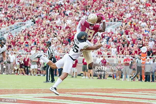 Wide receiver Auden Tate of the Florida State Seminoles catches a pass for a touchdown in front of defensive back Brad Watson of the Wake Forest...