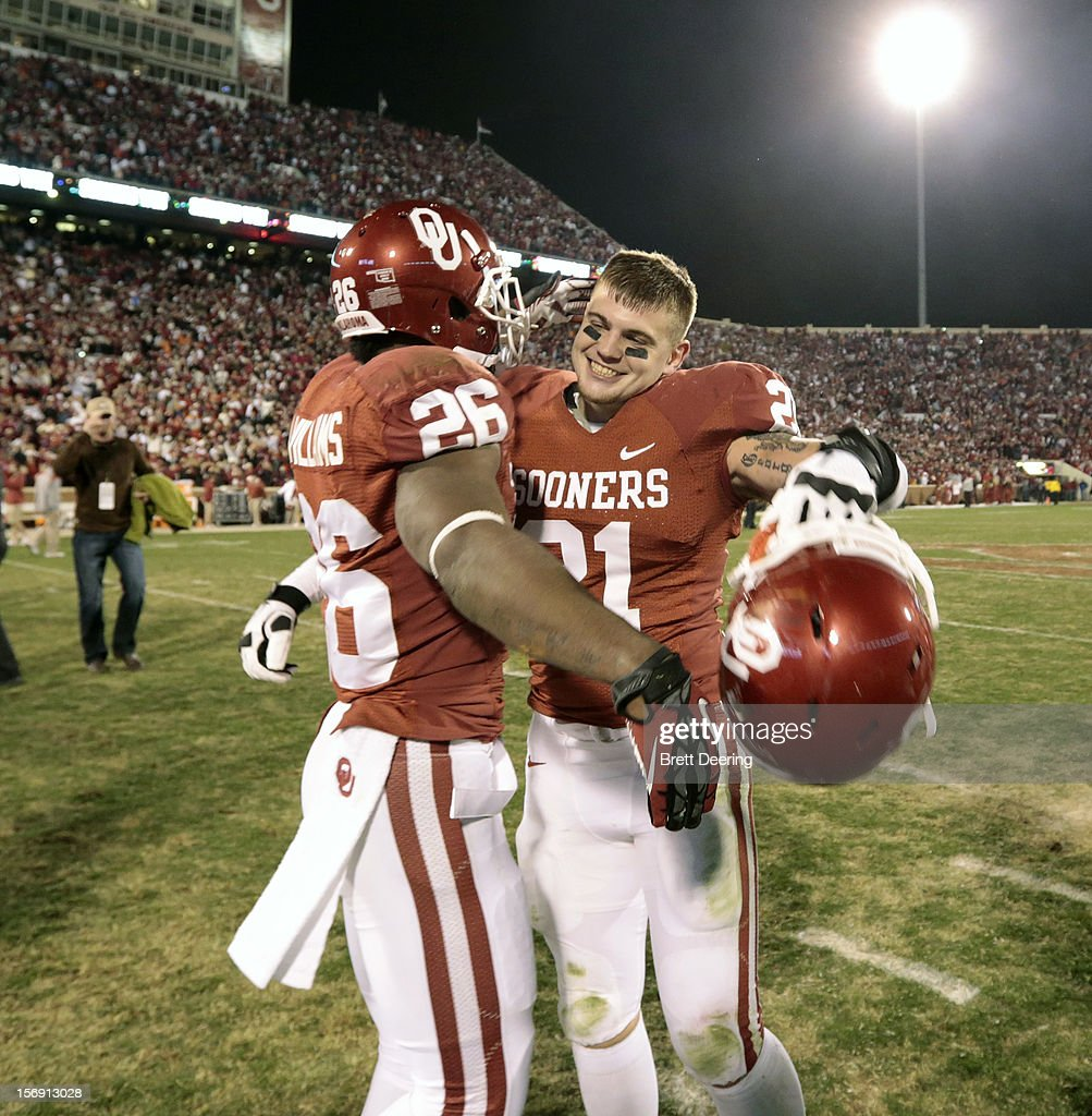 Wide receiver Austin Brown #21 and running back Damien Williams #26 of the Oklahoma Sooners celebrate after the game against the Oklahoma State Cowboys November 24, 2012 at Gaylord Family-Oklahoma Memorial Stadium in Norman, Oklahoma. Oklahoma defeated Oklahoma State 51-48 in overtime.