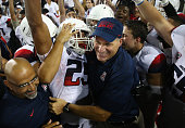 Wide receiver Austin Hill of the Arizona Wildcats celebrates with head coach Rich Rodriguez after catching the game winning 47 yard touchdown...