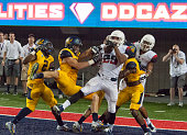 Wide receiver Austin Hill of the Arizona Wildcats makes a one handed touchdown catch to defeat the California Golden Bears 49 to 45 at Arizona...