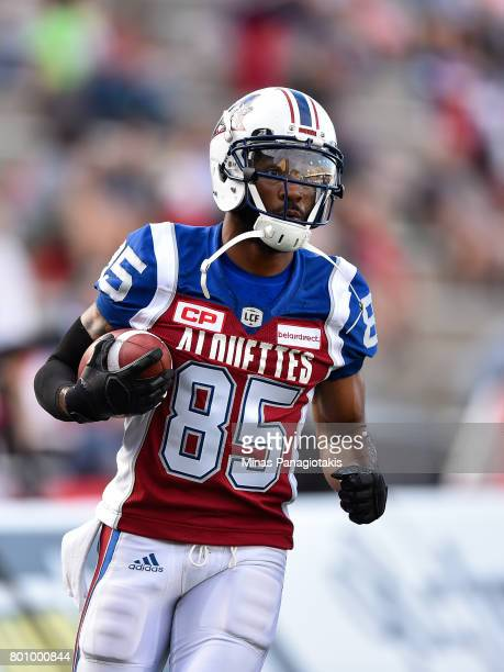 Wide receiver BJ Cunningham of the Montreal Alouettes runs with the ball during the warmup prior to the CFL game against the Saskatchewan Roughriders...