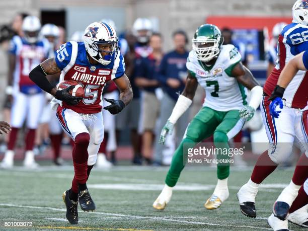 Wide receiver BJ Cunningham of the Montreal Alouettes runs with the ball against the Saskatchewan Roughriders during the CFL game at Percival Molson...