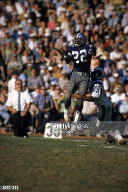Wide receiver Bob Hayes of the Dallas Cowboys catches a pass in front of defensive back Jim Nettles the Los Angeles Rams on November 23 1969 at the...