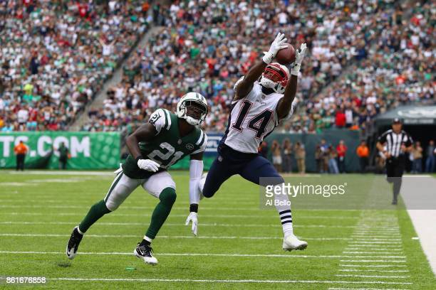 wide receiver Brandin Cooks of the New England Patriots makes a catch against cornerback Morris Claiborne of the New York Jets during the second...