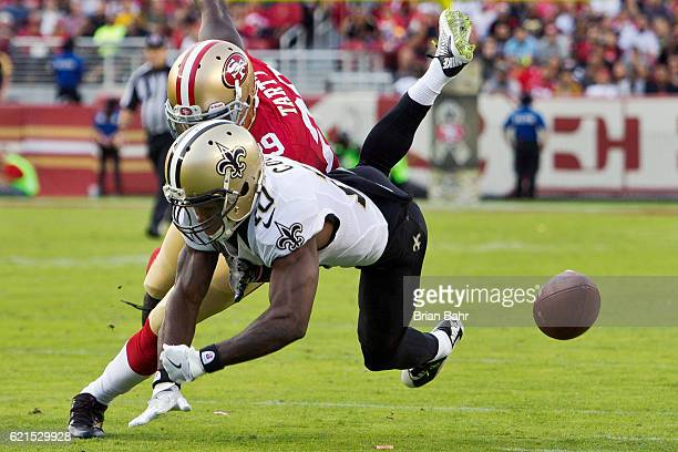Wide receiver Brandin Cooks of the New Orleans Saints can't hold onto the ball against safety Jaquiski Tartt of the San Francisco 49ers in the fourth...