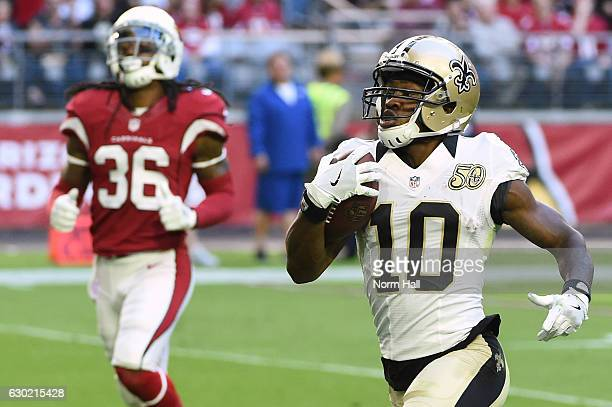 Wide receiver Brandin Cooks of the New Orleans Saints scores a 65 yard touchdown reception in front of free safety DJ Swearinger of the Arizona...