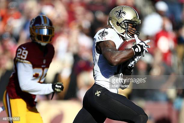 Wide receiver Brandin Cooks of the New Orleans Saints scores a second quarter touchdown past cornerback Chris Culliver of the Washington Redskins at...