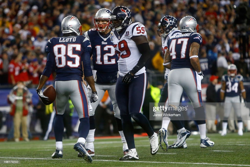 Wide receiver Brandon Lloyd #85 and quarterback Tom Brady #12 of the New England Patriots react after Lloyd catches a 37-yard touchdown pass in the first quarter against the Houston Texans at Gillette Stadium on December 10, 2012 in Foxboro, Massachusetts.