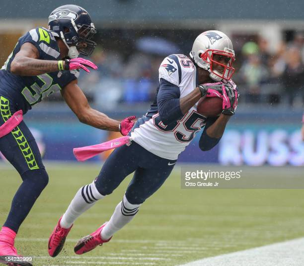 Wide receiver Brandon Lloyd of the New England Patriots makes a catch against cornerback Brandon Browner of the Seattle Seahawks at CenturyLink Field...
