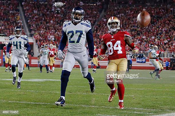 Wide receiver Brandon Lloyd of the San Francisco 49ers is unable to get to an overthrown pass against cornerback Tharold Simon of the Seattle...
