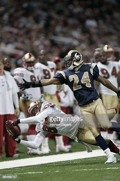 Wide receiver Brandon Lloyd of the San Francisco 49ers makes a reception against cornerback DeJuan Groce of the St Louis Rams on December 24 2005 at...