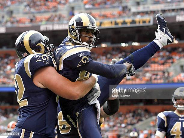 Wide receiver Brandon Lloyd of the St Louis Rams celebrates after scoring a touchdown with Harvey Dahl against the Cleveland Browns at Cleveland...