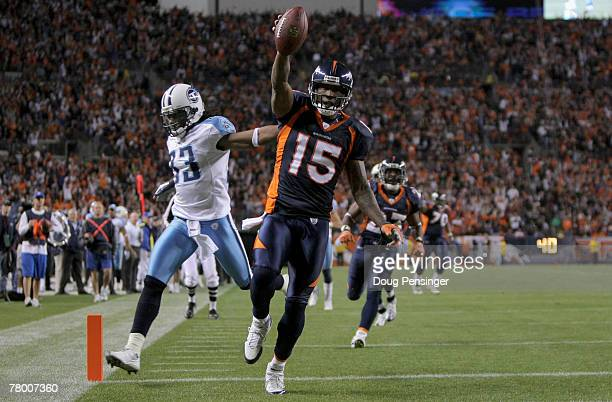 Wide receiver Brandon Marshall of the Denver Broncos begins to celebrate as he beats safety Michael Griffin of the Tennessee Titans to the enzone as...
