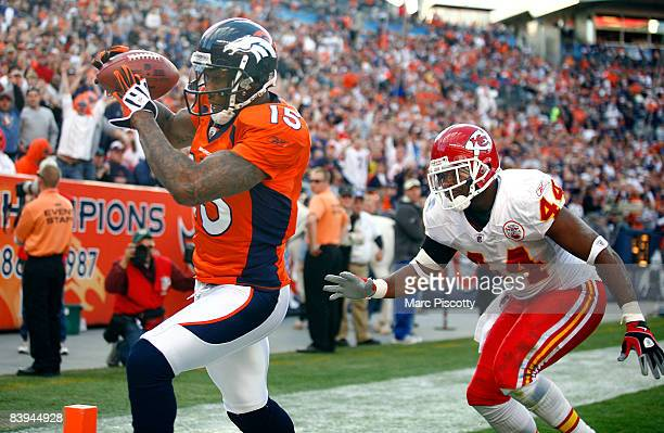 Wide receiver Brandon Marshall of the Denver Broncos catches a touchdown pass in front of Jarrad Page of the Kansas City Chiefs during the second...
