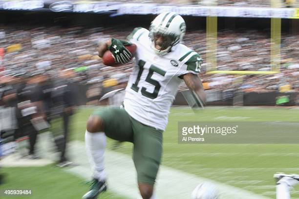 Wide Receiver Brandon Marshall of the New York Jets has a big gain against the Oakland Raiders at Oco Coliseum on November 1 2015 in Oakland...