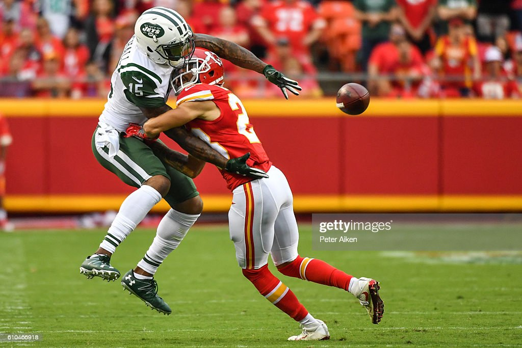 Wide receiver Brandon Marshall #15 of the New York Jets trys to make a catch through cornerback Phillip Gaines #23 of the Kansas City Chiefs at Arrowhead Stadium during the fourth quarter of the game on September 25, 2016 in Kansas City, Missouri.