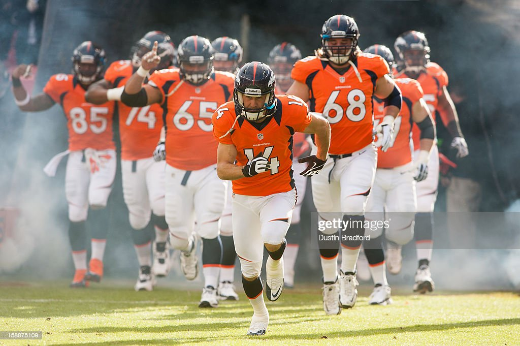 Wide receiver Brandon Stokley #14 of the Denver Broncos leads the charge out of the tunnel before a game against the Kansas City Chiefs at Sports Authority Field at Mile High on December 30, 2012 in Denver, Colorado. The Broncos defeated the Chiefs 38-3.