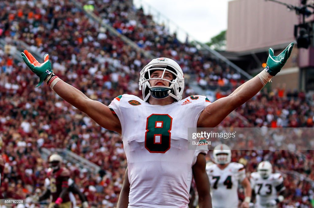 Wide receiver Braxton Berrios #8 of the Miami Hurricanes celebrates after scoring a touchdown during the second half of an NCAA football game against the Florida State Seminoles at Doak S. Campbell Stadium on October 7, 2017 in Tallahassee, Florida.