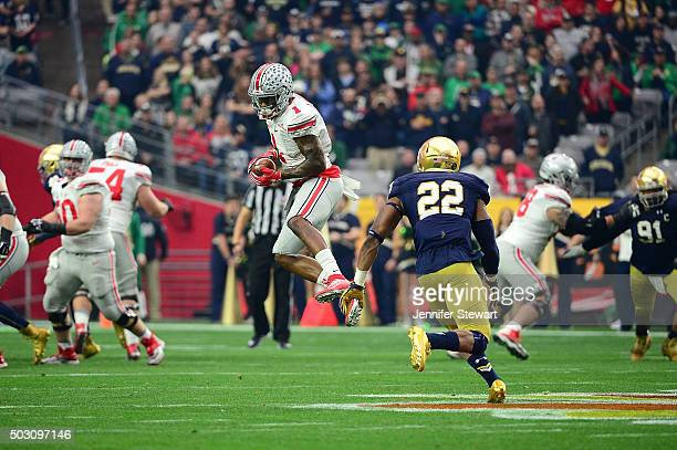Wide receiver Braxton Miller of the Ohio State Buckeyes hauls in a pass over safety Elijah Shumate of the Notre Dame Fighting Irish during the first...