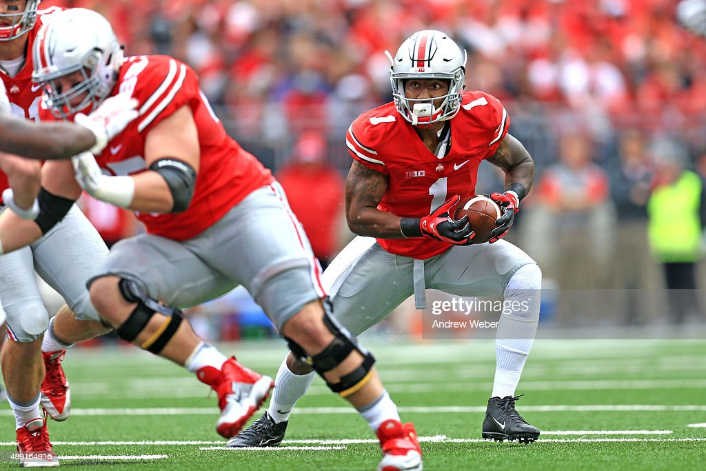 Wide receiver <a gi-track='captionPersonalityLinkClicked' href=/galleries/search?phrase=Braxton+Miller&family=editorial&specificpeople=7122480 ng-click='$event.stopPropagation()'>Braxton Miller</a> #1 of the Ohio State Buckeyes looks to run the ball in the first quarter against the Northern Illinois Huskies at Ohio Stadium on September 19, 2015 in Columbus, Ohio.