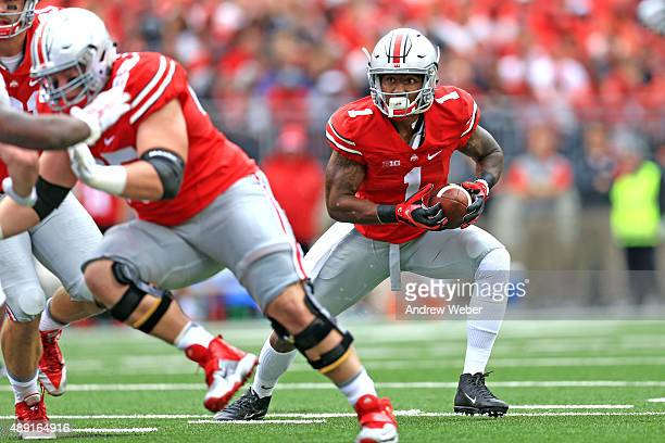 Wide receiver Braxton Miller of the Ohio State Buckeyes looks to run the ball in the first quarter against the Northern Illinois Huskies at Ohio...