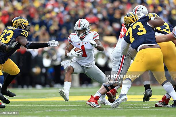 Wide receiver Braxton Miller of the Ohio State Buckeyes runs the ball during the game against the Michigan Wolverines at Michigan Stadium on November...
