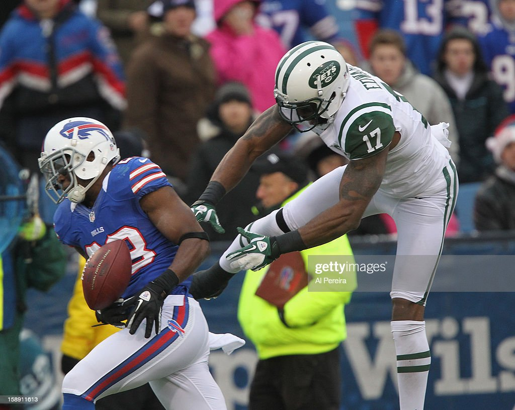 Wide Receiver Braylon Edwards #17 of the New York Jets battles for the ball with Cornerback Aaron Williams #23 of the Buffalo Bills when the Buffalo Bills host the New York Jets at Ralph Wilson Stadium on December 30, 2012 in Orchard Park, New York.