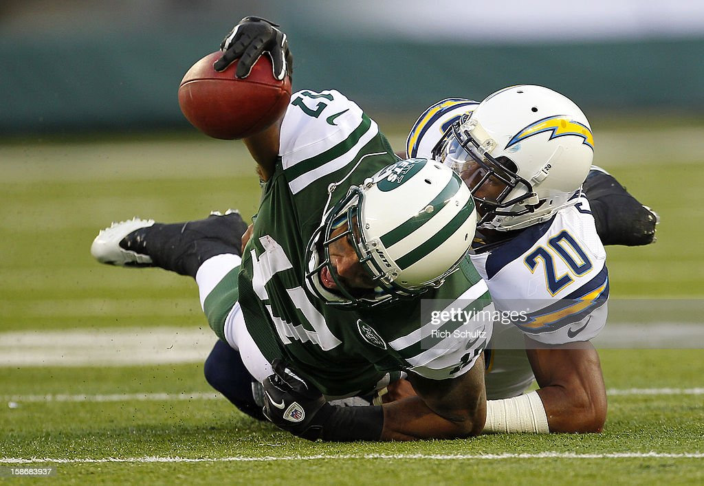 Wide receiver <a gi-track='captionPersonalityLinkClicked' href=/galleries/search?phrase=Braylon+Edwards&family=editorial&specificpeople=210552 ng-click='$event.stopPropagation()'>Braylon Edwards</a> #17 of the New York Jets is tackled by <a gi-track='captionPersonalityLinkClicked' href=/galleries/search?phrase=Antoine+Cason&family=editorial&specificpeople=2803078 ng-click='$event.stopPropagation()'>Antoine Cason</a> #20 of the San Diego Chargers during the second half at MetLife Stadium on December 23, 2012 in East Rutherford, New Jersey. The Chargers defeated the Jets 27-17.