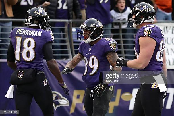 Wide receiver Breshad Perriman of the Baltimore Ravens celebrates with teammates wide receiver Steve Smith and tight end Nick Boyle after scoring a...