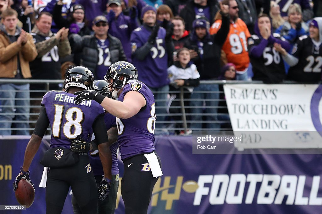 Wide receiver Breshad Perriman #18 of the Baltimore Ravens celebrates with teammates wide receiver Steve Smith #89 and tight end Nick Boyle #86 after scoring a fourth quarter touchdown against the Miami Dolphins at M&T Bank Stadium on December 4, 2016 in Baltimore, Maryland.