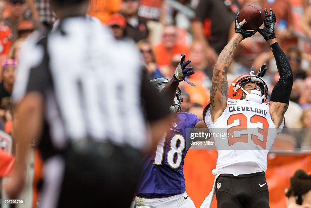 Wide receiver Breshad Perriman #18 of the Baltimore Ravens tries to make the catch as cornerback Joe Haden #23 of the Cleveland Browns makes an interception on a throw from quarterback Joe Flacco #5 during the second half at FirstEnergy Stadium on September 18, 2016 in Cleveland, Ohio. The Ravens defeated the Browns 25-20.