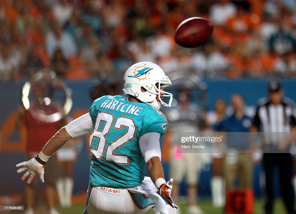 Wide receiver <a gi-track='captionPersonalityLinkClicked' href=/galleries/search?phrase=Brian+Hartline&family=editorial&specificpeople=3485995 ng-click='$event.stopPropagation()'>Brian Hartline</a> #82 of the Miami Dolphins cannot make a catch against the Tampa Bay Buccaneers at Sun Life Stadium on August 24, 2013 in Miami Gardens, Florida.