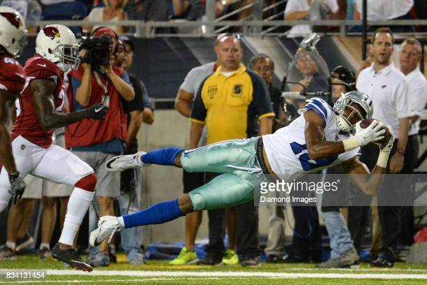 Wide receiver Brice Butler of the Dallas Cowboys dives to catch a pass in the second quarter of the 2017 Pro Football Hall of Fame Game on August 3...