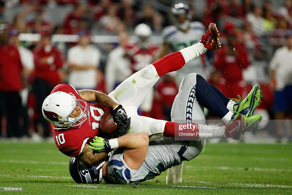 Wide receiver Brittan Golden #10 of the Arizona Cardinals is tackled by middle linebacker Brock Coyle #52 of the Seattle Seahawks during the NFL game at the University of Phoenix Stadium on January 3, 2016 in Glendale, Arizona. The Seahawks defeated the Cardinals 36-6.