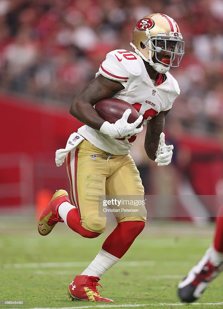 Wide receiver <a gi-track='captionPersonalityLinkClicked' href=/galleries/search?phrase=Bruce+Ellington&family=editorial&specificpeople=7405384 ng-click='$event.stopPropagation()'>Bruce Ellington</a> #10 of the San Francisco 49ers runs with the football during the NFL game against the Arizona Cardinals at the University of Phoenix Stadium on September 21, 2014 in Glendale, Arizona. The Cardinals defeated the 49ers 23-14.