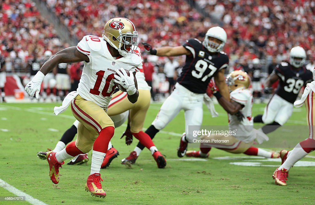 Wide receiver <a gi-track='captionPersonalityLinkClicked' href=/galleries/search?phrase=Bruce+Ellington&family=editorial&specificpeople=7405384 ng-click='$event.stopPropagation()'>Bruce Ellington</a> #10 of the San Francisco 49ers runs with the football after a reception against the Arizona Cardinals during the NFL game at the University of Phoenix Stadium on September 21, 2014 in Glendale, Arizona. The Cardinals defeated the 49ers 23-14.